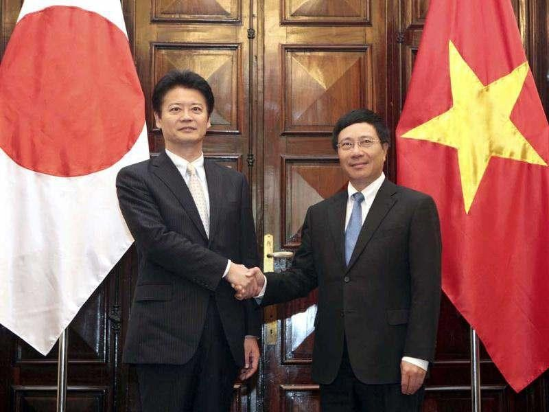 Japanese foreign minister Koichiro Gemba, left, shakes hands with his Vietnamese counterpart Pham Binh Minh at the Government Guest House in Hanoi, Vietnam. Gemba is on a two-day visit to Vietnam.(AP Photo/Luong Thai Linh, Pool)
