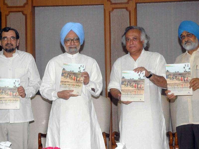 Prime minister Manmohan Singh with rural development minister Jairam Ramesh, deputy chairman, planning commission, Montek Singh Ahluwalia and co-founder, Samaj Pragati Sahayog, Mihir Shah (L) releasing a report on Mahatma Gandhi National Rural Employment Guarantee Act MGNREG in New Delhi on Saturday. Agencies