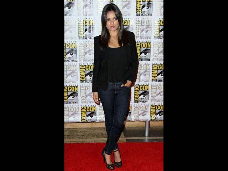 Mila Kunis, from the film Oz: The Great and Powerful, arrives at the Disney press line during Comic-Con (AP)