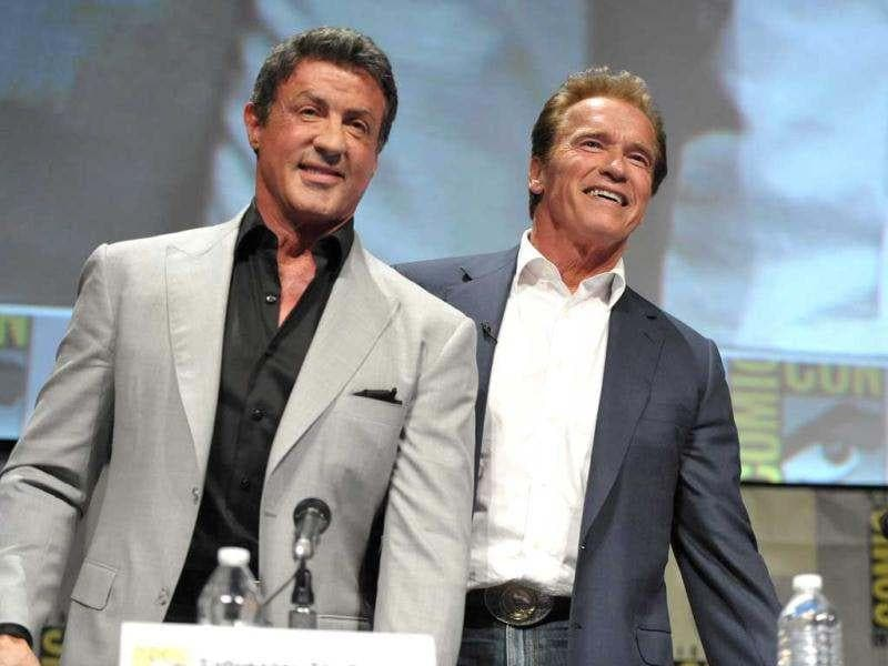 Sylvester Stallone and Arnold Schwarzenegger attend The Expendables Panel at Comic-Con. (AP)