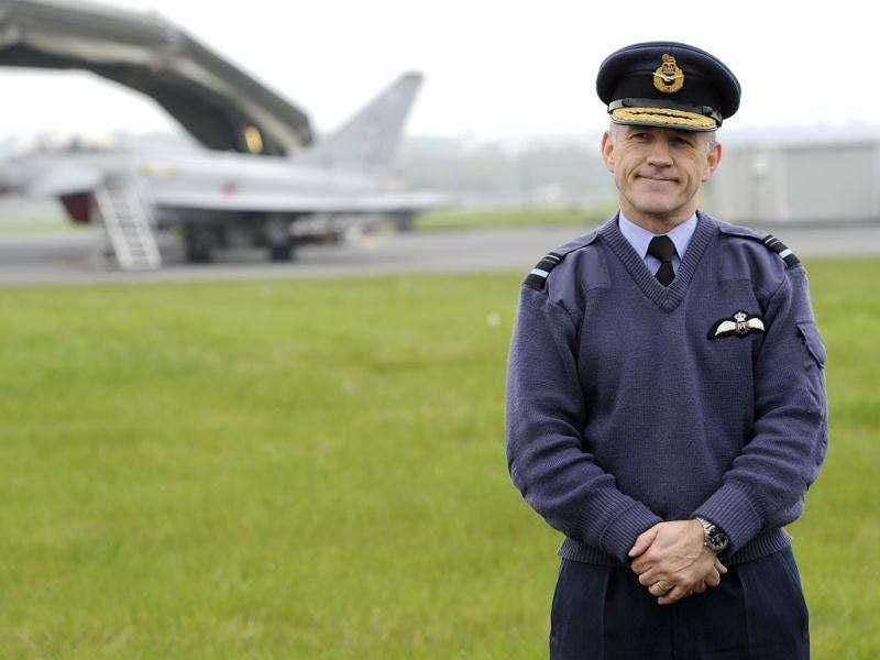 Air Vice Marshal Stuart Atha, the Air Component Commander for Olympics Air Security, poses for photographers at RAF Northolt in west London. Four Typhoon jets arrived at the base on Wednesday to take part in defence exercises in advance of the London 2012 Olympic Games. Reuters/Paul Hackett