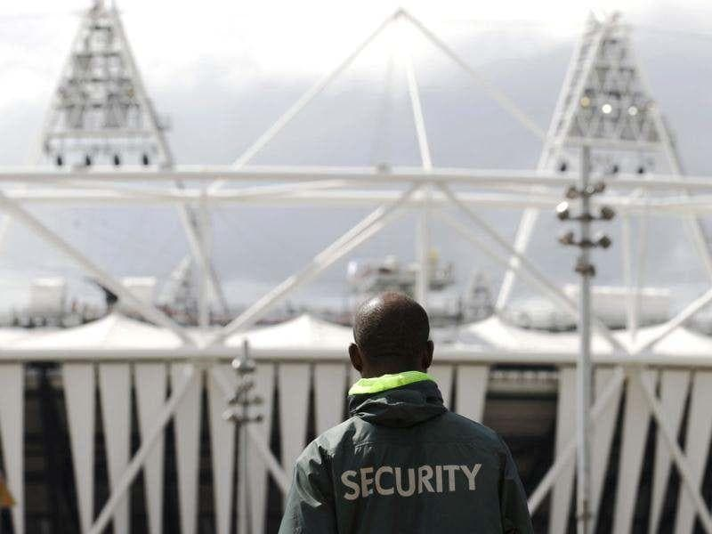 A security guard walks towards the Olympic Stadium in the London 2012 Olympic Park at Stratford in London. Britain's air force will be on standby to shoot down any rogue aircraft over London from Saturday under tight new restrictions being enforced two weeks ahead of the Olympic Games. Security surrounding the Olympics has made the headlines this week after Britain was forced to deploy 3,500 extra troops to fill an embarrassing last-minute shortfall in private security staff. Reuters/Luke MacGregor
