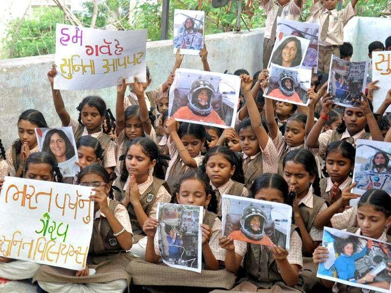 School children pray for the safe return of US astronaut of Indian origin Sunita Williams, during a ceremony in Ahmedabad. (PTI Photo)