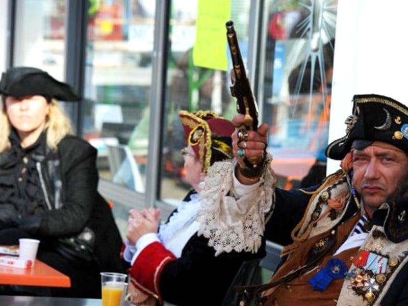 People disguised as pirates drink at a bar at the French western seaport of Brest as part of the 2012 Tonnerres de Brest maritime festival which features thousands of traditional sailboats.(AFP Photo/Alain Jocard)