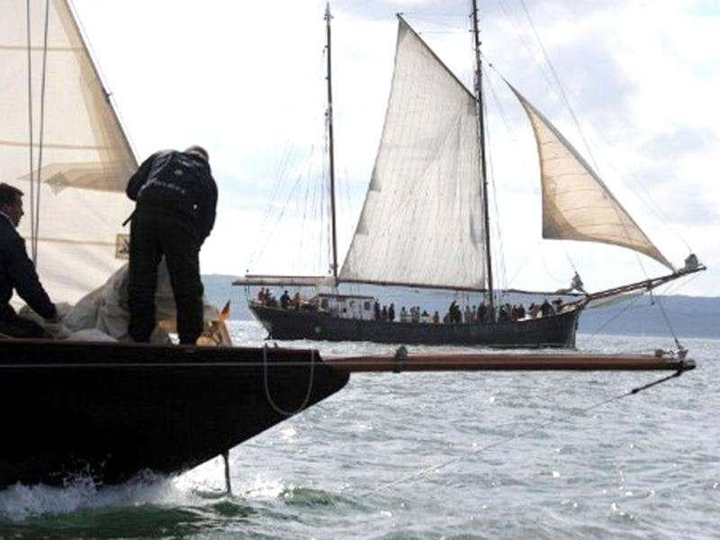 People sail a traditional sailboat in Brest seaport as part of the 2012 Tonnerres de Brest maritime festival which features thousands of traditional sailboats.(AFP Photo/Alain Jocard)