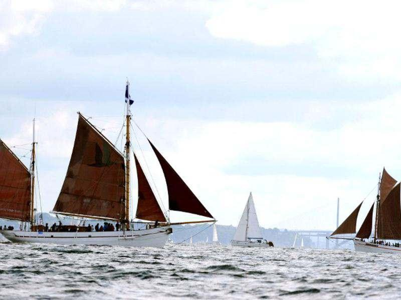 Traditional boats sail in Brest seaport as part of the 2012 Tonnerres de Brest maritime festival which features thousands of traditional sailboats.(AFP Photo/Alain Jocard)