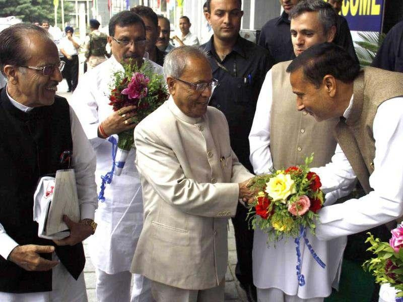 Congress minister Sham lal sharma recives Presidential candidate of Congress Pranab Mukherji at international convocation complex on the banks of Dal Lake in Srinagar, India. Mukherji landed in Valley in the morning to woo the ruling National conference in coalition with state congress for their votes in the Presidential elections later this month. HT/Waseem Andrabi