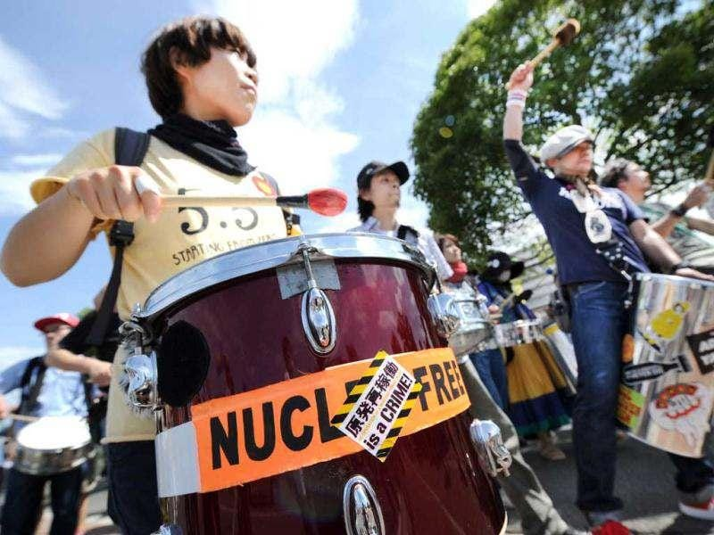 Anti-nuclear protesters beat drums as they stage a demonstration in Funabashi, suburban Tokyo. A series of increasingly large gatherings have been held in Tokyo since the tsunami-sparked disaster at Fukushima, with protestors demanding an end to nuclear power. (AFP Photo / Toru Yamanaka)