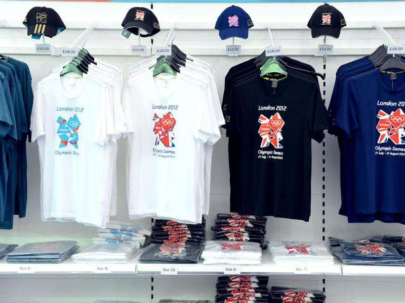 London Olympic t-shirts and base-ball caps are displayed at the largest pop-up store in Hyde Park, London. AFP/Miguel Medina