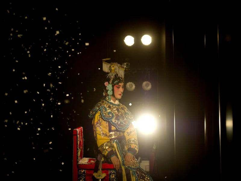 A performer sitting onstage during a performance at the Temple Theatre of the Beijing Opera House in Beijing. Beijing's Temple Theatre performs titles by late 20th century opera icon Mei Lanfang such as 'Drunken Princess' and 'Sylph Scattering Flowers' in 100-minute shows for tourists and aficionados alike. AFP/Ed Jones