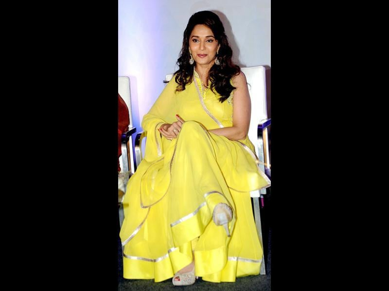 Bollywood beauty Madhuri Dixit makes a bright appearance in a yellow attire for the launch of Its Only Cinema magazine in Mumbai on July 14.