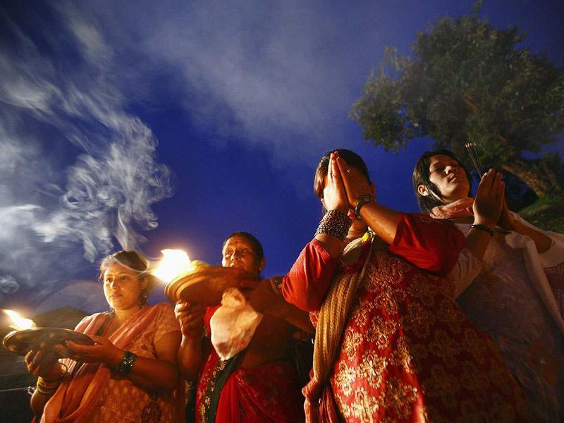 Hindu devotees offer prayers at the Pashupatinath temple as they take part in the