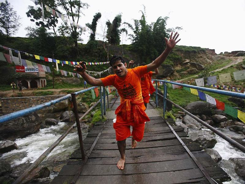A Hindu devotee gestures as he takes part in the
