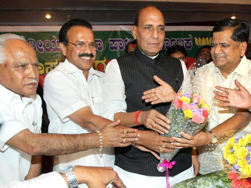 Jagadish Shettar (R) being greeted by BJP leader Rajnath Singh, outgoing Karnataka chief minister Sadananda Gowda and BS Yeddyurappa after he was formally elected as the BJP legislature party leader, in Bengaluru. PTI Photo by Shailendra Bhojak