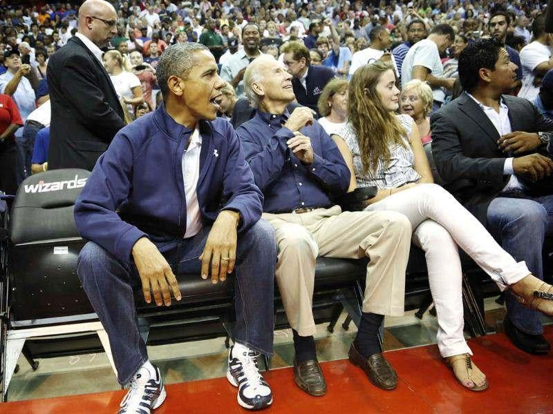 US President Barack Obama and Vice President Joe Biden arrive to attend an Olympic basketball exhibition game between the US and Brazil national men's teams in Washington. Reuters/Jonathan Ernst