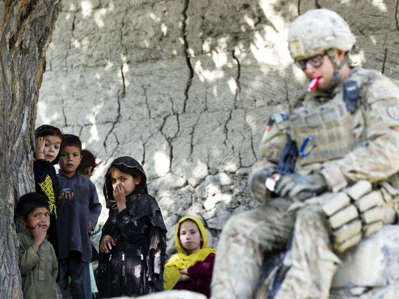 Afghan children react as they watch a paratrooper from Chosen Company of the 3rd Battalion (Airborne), 509th Infantry provide security while on a helicopter assault mission to improve their biological database of fighting aged males, near the town of Ahmad Khel in Afghanistan's Paktiya Province. Reuters photo/Lucas Jackson