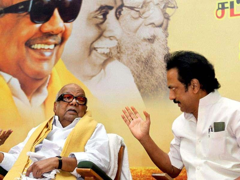 DMK chief M Karunanidhi along with his son MK Stalin at a meeting of party's MPs and MLAs on presidential poll, in Chennai. PTI Photo by R Senthil Kumar
