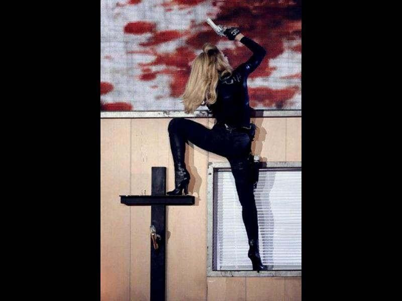 Madonna even climbed the Holy Cross with her silver pistol.