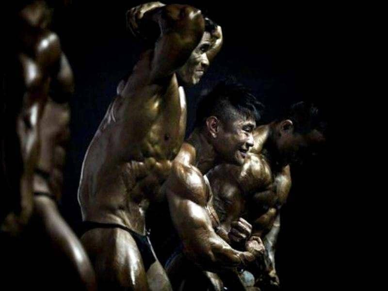 Participants compete in the 2012 International Bodybuilding and Fitness Invitation Championship in Hong Kong. Participants do a series of mandatory poses and display their best shaped muscles to a panel of judges who assign points based on their appearance. AFP/Philippe Lopez