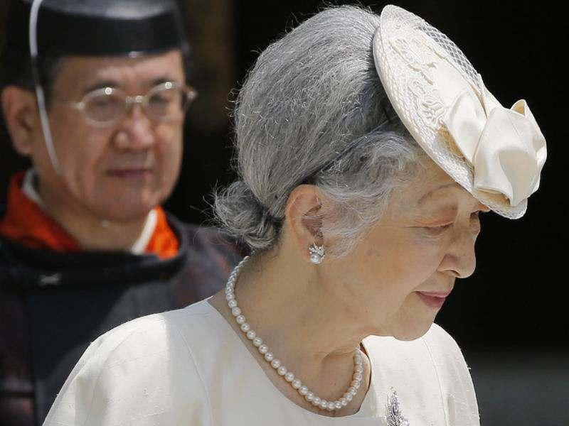 Japan's Empress Michiko leaves after offering prayers at Meiji Shrine where Emperor Akihito's great-grandfather Emperor Mutsuhito's spirit is dedicated, in Tokyo. (AP Photo/Itsuo Inouye)