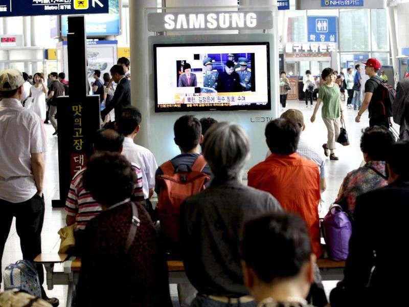 South Koreans watch a TV reporting on North Korean leader Kim Jong Un, at a railway station in Seoul, South Korea. (AP Photo/Ahn Young-joon)