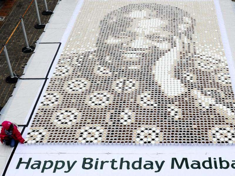 In this photo a mosaic of various coffees make up a giant mosaic portrait of former South African President Nelson Mandela, affectionately know as