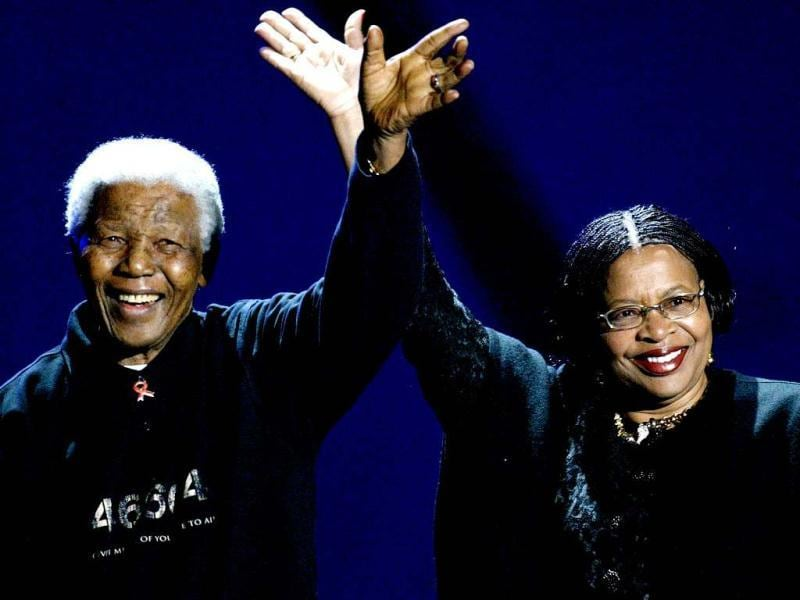 Former South African president Nelson Mandela and his wife Graca Machel, wave to the audience during a Live 8 concert in Johannesburg, South Africa. (AP file photo)