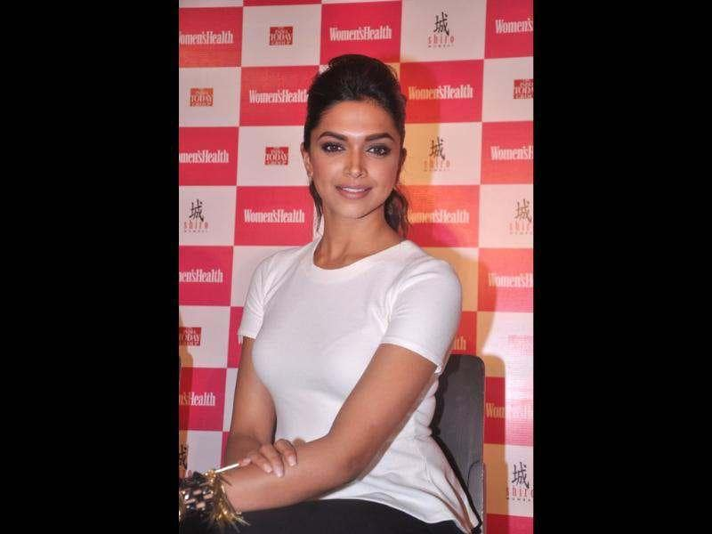 Deepika poses for a smile at the launch.