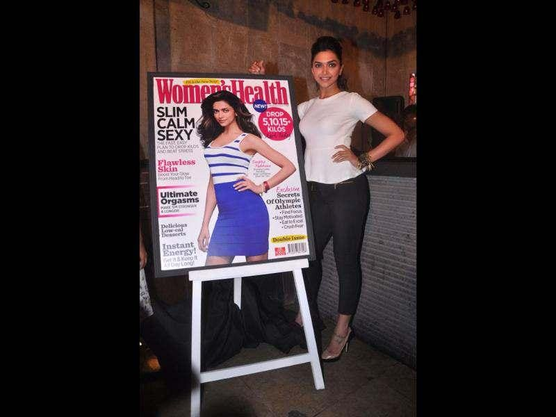 Deepika poses next to the health magazine.
