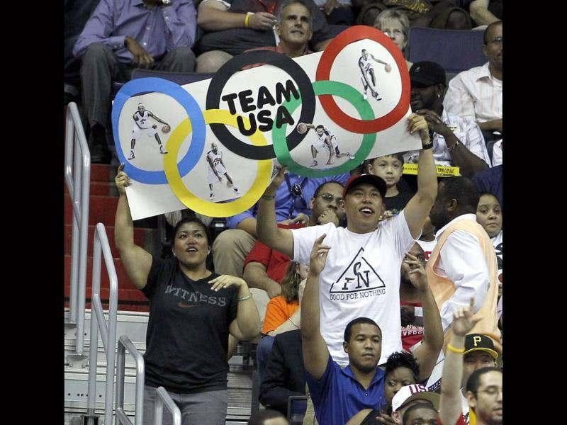 Fans hold an Olympic Rings sign for Team USA during the first half of an Olympic men's exhibition basketball game against Brazil, in Washington. AP/Alex Brandon