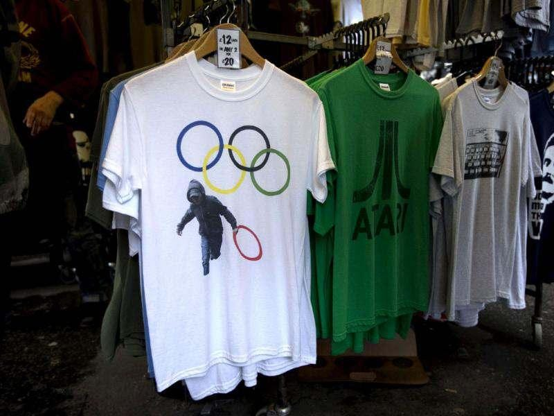 A t-shirt depicting a rioter holding an Olympic ring is displayed on sale in a London market. AP/Matt Dunham