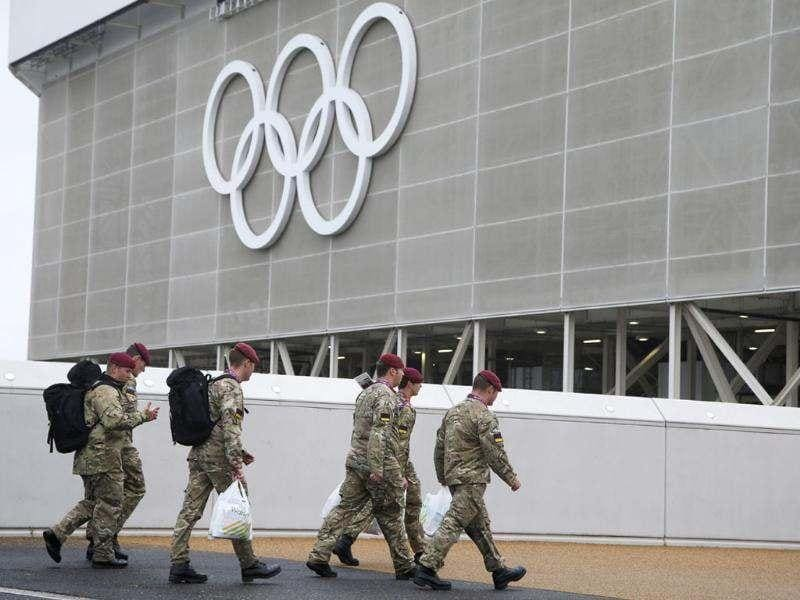 British military personnel walk past the aquatic center in the Olympic Park before the start of the 2012 Summer Olympics, in London. AP/Jae Hong