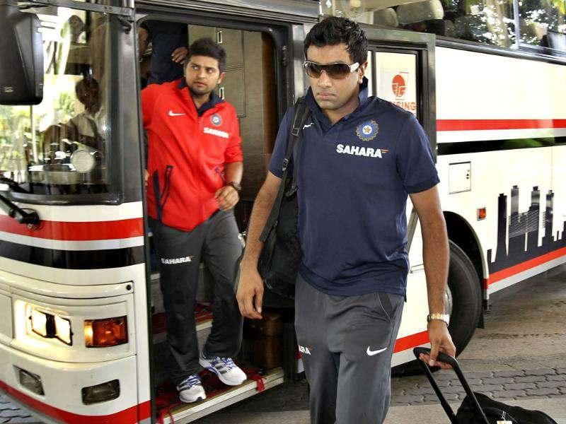 Ravichandran Ashwin, right, and Suresh Raina arrive with the Indian cricket team in Colombo. AP/Gemunu Amarasinghe