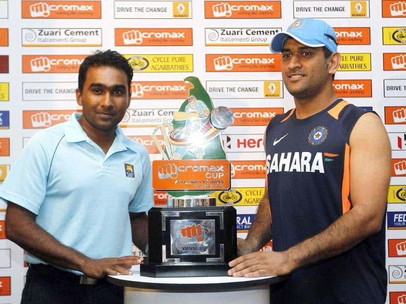 Mahendra Singh Dhoni (R) and Sri Lankan captain Mahela Jayawardene pose with the trophy during a news conference ahead of their One Day International cricket series with Sri Lanka, in Colombo. Reuters photo