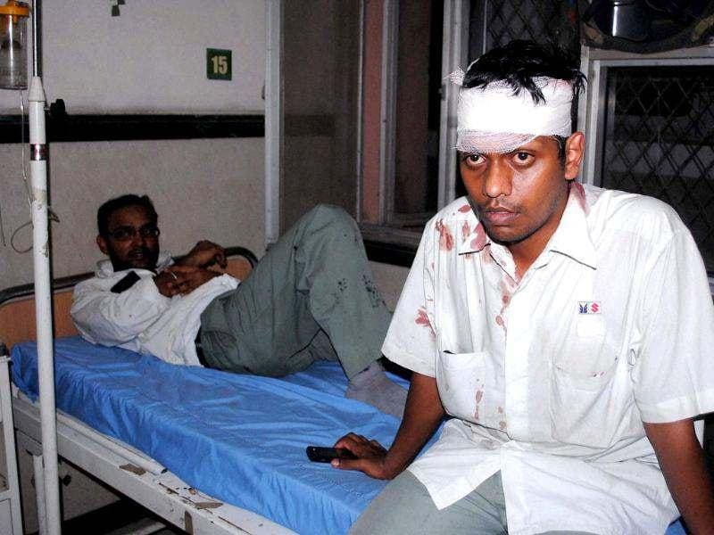 Injured workers of Maruti Suzuki's Manesar plant, recover in a hospital, following a clash. PTI
