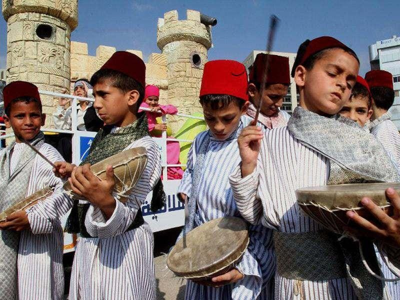 Lebanese orphans play traditional drums during a ceremony to celebrate the upcoming Muslim holy fasting month of Ramadan in Beirut. Muslims around the world celebrate Ramadan, the holiest month in the Islamic calender, in which they abstain from eating, drinking and conducting sexual relations from sunrise to sunset. (AFP Photo/Anwar Amro)