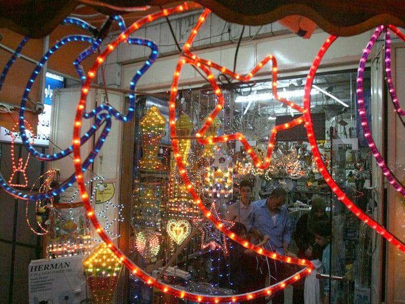 Ramadan decorations are hung outside a shop in the West Bank city of Hebron to welcome the upcoming Muslim holy fasting month of Ramadan. (AFP Photo/ Hazem Bader)