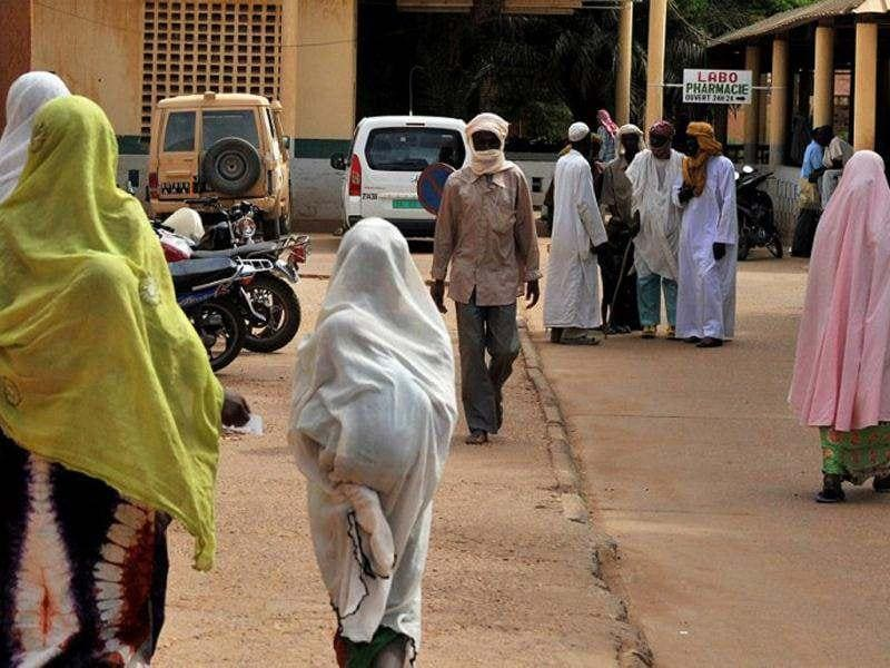This picture shows people going about their daily lives as they prepare for the Islmaic holy month of Ramadan in Gao. Normally a joyous time of fasting and prayer, the looming Muslim month of Ramadan has raised fears of stricter rule by the jihadists occupying the north Malian town of Gao. (AFP Photo/ Issouf Sanogo)