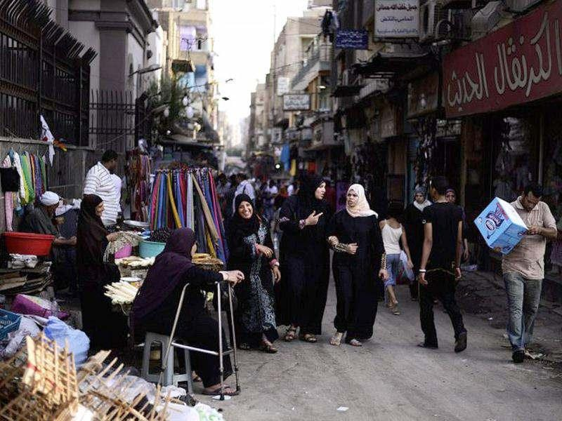 Egyptians shops for food and amenities at street market in Cairo, on the eve of the first day of the holy Muslim month of Ramadan. Muslims believe that the Koran was sent down to the lowest heaven during this month, thus being prepared for gradual revelation by the Angel Jibraeel or Gabriel to the Islamic prophet Muhammad. (AFP Photo/Gianluigi Guercia)