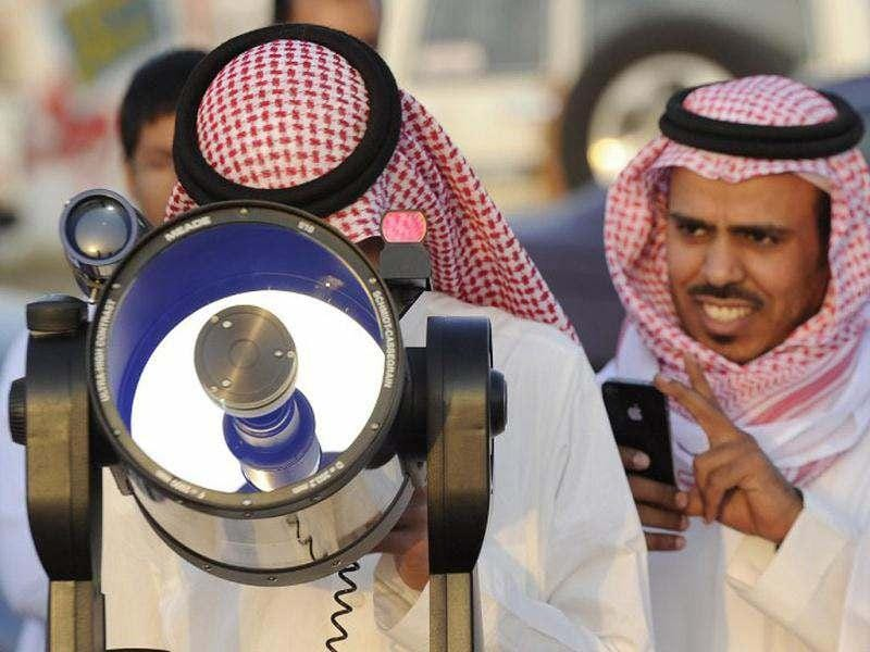 Saudis use a telescope to monitor the new moon of Ramadan as astronomers and scholars of Islam debate when the holy Muslim month of Ramadan begins, in the Saudi city of Taif. The start of the fasting month is determined by the sighting of the new moon. (AFP Photo/Amer Hilabi)