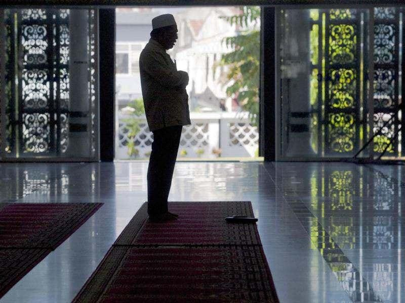 An Indonesian Muslim attends prayer at Baiturrahman mosque in Banda Aceh before the start of the holy month of Ramadan. (AFP Photo/Chaideer Mahyuddin)