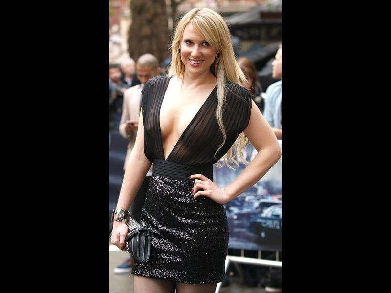 British actress Rebecca Ferdinando poses for photographers upon arrival at the European premiere of the film The Dark Knight Rises. (AFP)
