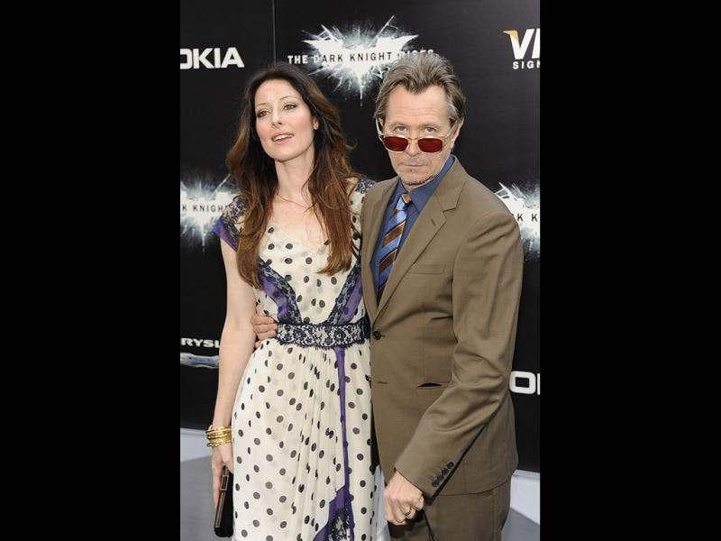 Actor Gary Oldman and wife Alexandra Edenborough arrive to the world premiere of The Dark Knight Rises. (AP)