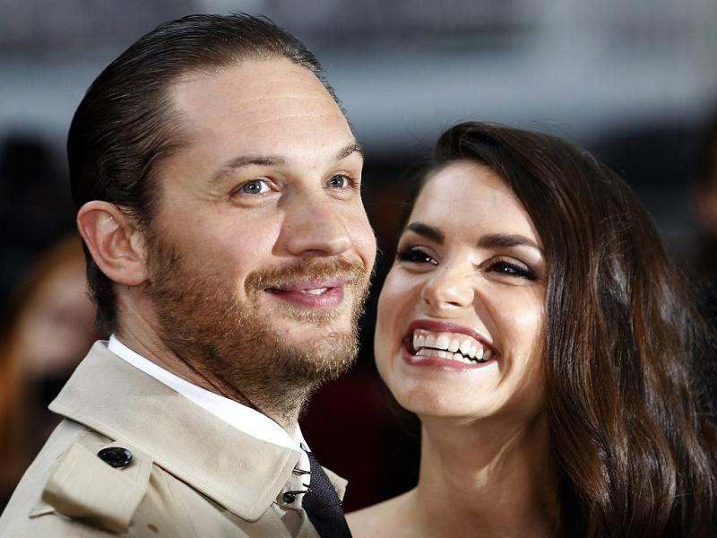 British actor Tom Hardy and his girlfriend Charlotte Riley pose for photographers as they arrive at the European premiere of The Dark Knight Rises. (Reuters)
