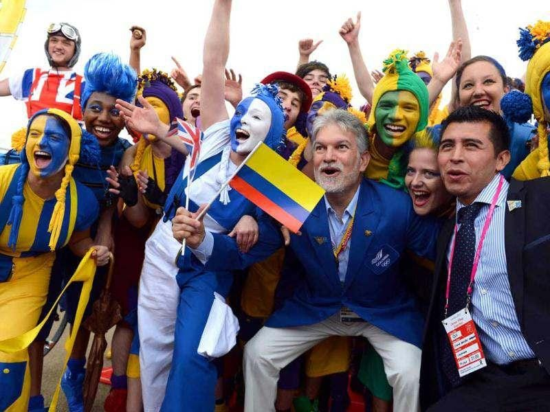 Members of the Colombian delegation (C and R) are welcomed by members of the National Youth Theatre of Great Britain during a Welcoming Ceremony for athletes and delegates at the London 2012 Olympic Village in the Olympic Park in east London. AFP/Miguel Medina