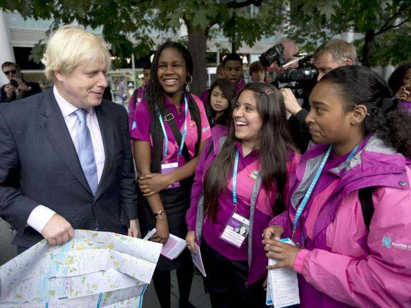 London mayor Boris Johnson chats with young ambassadors next to a new information