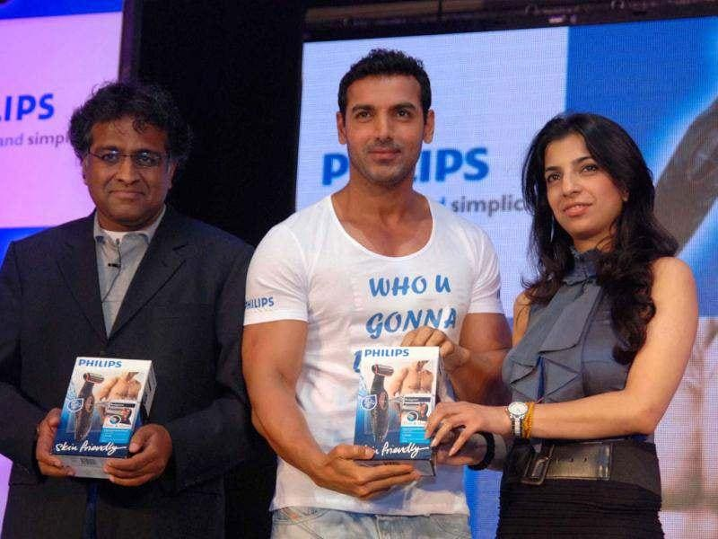 John Abraham with ADA Ratnam, president, Consumer Lifestyle Indian Sub Continentel Philips Electronics India Ltd and Aarushi Agarwal.