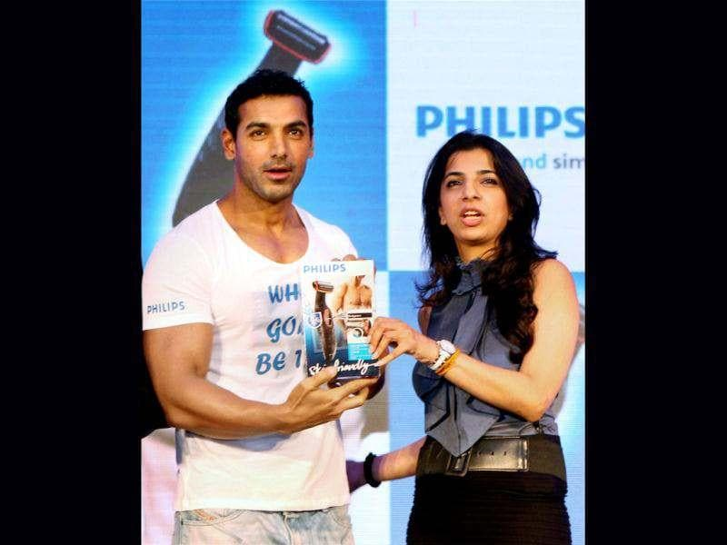 John Abraham poses with Aarushi Agarwal, Director Marketing, Consumer Lifestyle at Philip.