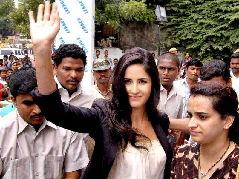 Katrina Kaif waves at her fans after inaugrating the jewellery showroom in Hyderabad.