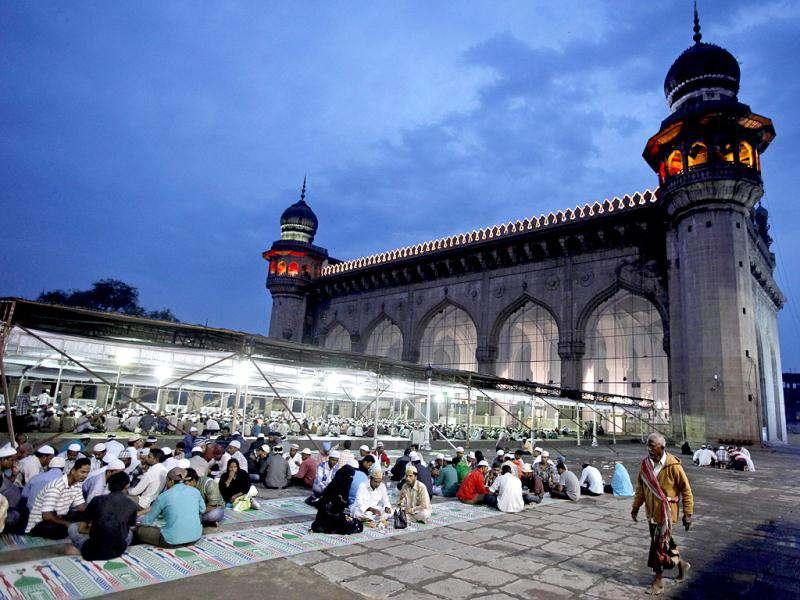 Muslims break their fast on the first day of Ramadan at Mecca Masjid in Hyderabad. Muslims throughout the world are marking the month of Ramadan, the holiest month in Islamic calendar. (AP Photo)